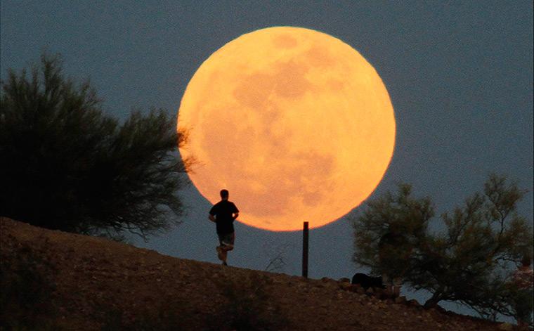 A runner makes his way along a trail at Papago Park in Phoenix, Arizona